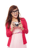 Retro photographer. Excited woman holding in hands old camera Royalty Free Stock Image