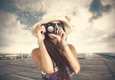 Retro photographer. Girl retro photographer with photo camera Stock Photography