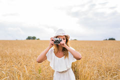 Retro photographer using old camera. In nature Royalty Free Stock Photo