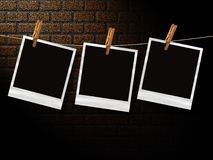 Retro photos in front of brick wall Stock Photos