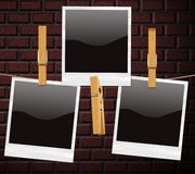 Retro Photos over Brick Wall Royalty Free Stock Photo