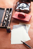 Retro photos vintage ink pen blotter camera Stock Photo