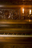 Retro piano with candle light. Retro Piano with ivory keys and candle light Royalty Free Stock Photography