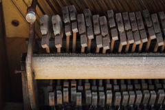 Retro Piano Hammer Detail. Piano hammers from a vintage piano.  Musical background or detail Stock Images