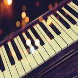 Retro piano keys with bokeh lights. Effect Stock Photography