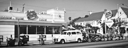 Retro pic from Johnny Rockets LA Black&White. Retro pic from Johnny Rockets Hamburgers in Los Angeles, California with parked Harley Davidsson motorbikes outside Stock Photo