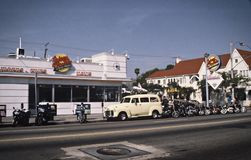Retro pic from Johnny Rockets LA. Retro pic from Johnny Rockets Hamburgers in Los Angeles, California with parked Harley Davidsson motorbikes outside and old Royalty Free Stock Image