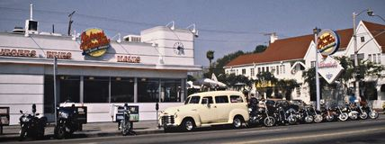 Retro pic from Johnny Rockets LA. Retro pic from Johnny Rockets Hamburgers in Los Angeles, California with parked Harley Davidsson motorbikes outside and old Stock Photos