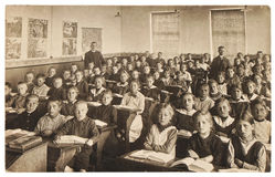 Retro picture of classmates. Group of children in the classroom Royalty Free Stock Photos