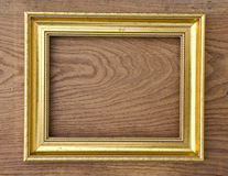 Retro picture frame on oak wood plank background Stock Image