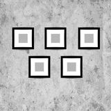 Retro picture frames on grunge wall for your Stock Images