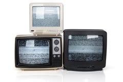Retro pila della TV con gli schermi statici fotografia stock libera da diritti