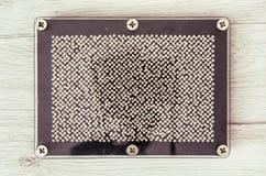 Retro pin board toy Stock Photo