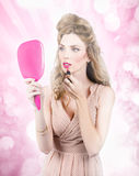 Retro pin up girl doing hair and make up Royalty Free Stock Image