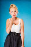 Retro pin up girl sending kiss. Stock Photo