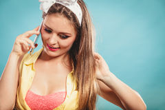 Retro pin up girl talking on mobile phone Stock Photos