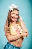 Retro pin up girl talking on mobile phone Royalty Free Stock Images