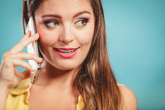 Retro pin up girl talking on mobile phone Stock Images
