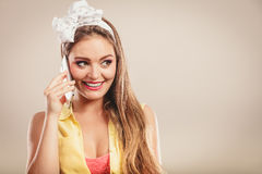 Retro pin up girl talking on mobile phone Royalty Free Stock Photography