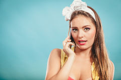Retro pin up girl talking on mobile phone Stock Photos