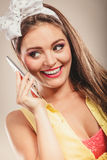 Retro pin up girl talking on mobile phone Royalty Free Stock Photo