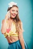 Retro pin up girl talking on mobile phone Stock Photo