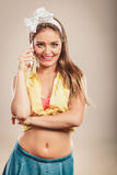 Retro pin up girl talking on mobile phone Stock Photography