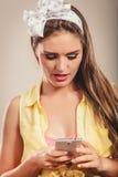 Retro pin up girl texting. Stock Photo