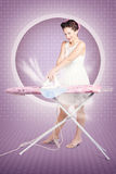Retro pin-up lady doing ironing in 50s fashion Stock Photo