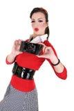 Retro pin up photo. Retro pin up woman holding vintage camera stock photography