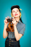 Retro pin-up woman with film camera Royalty Free Stock Images