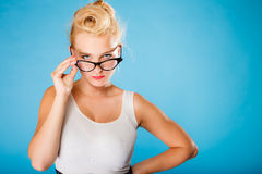 Retro pin up woman wearing eyeglasses. Stock Photography