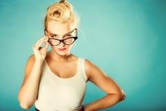 Retro pin up woman wearing eyeglasses. Stock Image