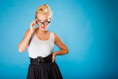 Retro pin up woman wearing eyeglasses. Stock Photo