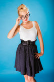 Retro pin up woman wearing eyeglasses. Stock Photo
