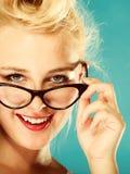 Retro pin up woman wearing eyeglasses. Royalty Free Stock Image