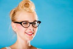 Retro pin up woman wearing eyeglasses. Royalty Free Stock Photography