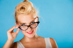 Retro pin up woman wearing eyeglasses. Royalty Free Stock Photos