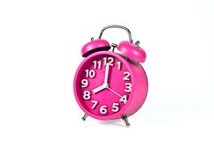 Retro pink alarm clock isolated Stock Images