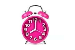 Retro pink alarm clock isolated Royalty Free Stock Photography