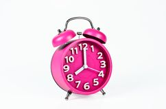 Retro pink alarm clock isolated Royalty Free Stock Photos
