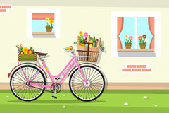 Retro Pink Bicycle with House Wall Stock Image