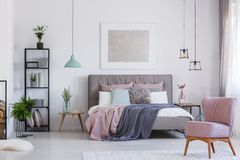 Pink chair in adorable bedroom stock photo