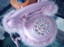 Retro pink desk telephone with plush Royalty Free Stock Images