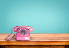Retro pink telephone Stock Images