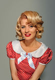 Retro pinup coquettish blonde girl Royalty Free Stock Photo