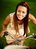 Retro pinup girl with bike. Portrait of pretty pinup girl with blue bycicle in retro style stock images