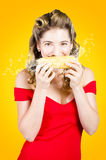 Retro pinup girl eating GMO free corn cob Stock Image