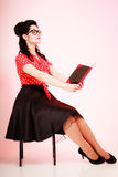 Retro. Pinup girl in eyeglasses reading book. Retro. Stylish woman student or teacher in eyeglasses reading book on pink. Brunette girl in pinup style. Education Royalty Free Stock Photography
