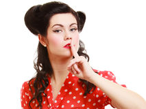 Retro. Pinup girl with finger on lips asking for silence Royalty Free Stock Image